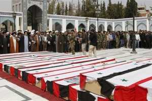 Syrians hold mass funeral for victims of Aleppo bombing